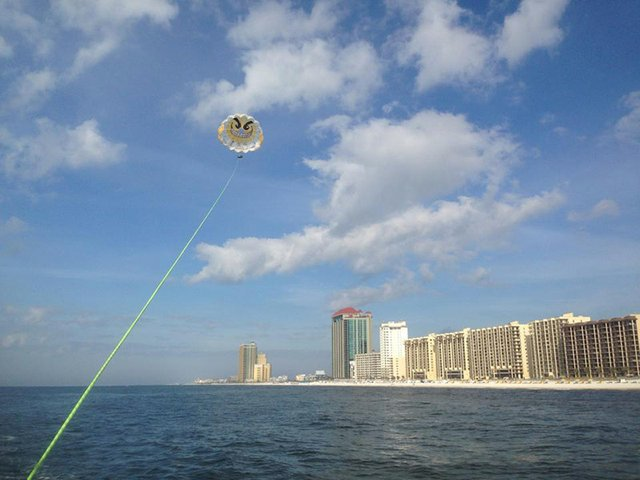 Soar above the Gulf on a parasail adventure.